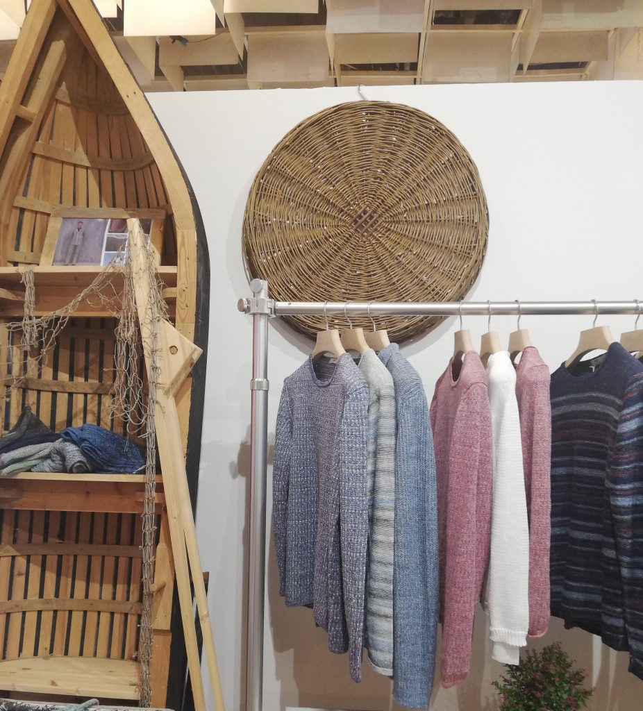 A shot of our Pitti Uomo 94 stand, which shows a classic Inis Meáin currach and our new SS19 collection of linen sweaters.